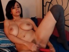 Model with large tits playing with dildo Thumb
